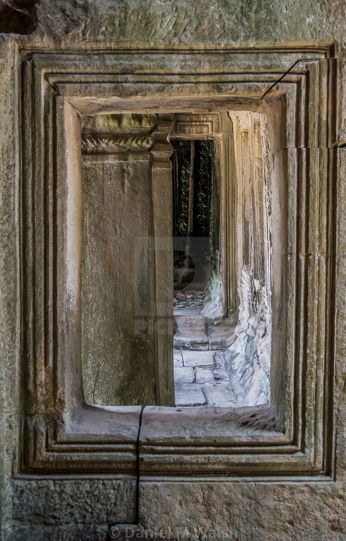 """Ancient Khmer carved stone window."" stock image"
