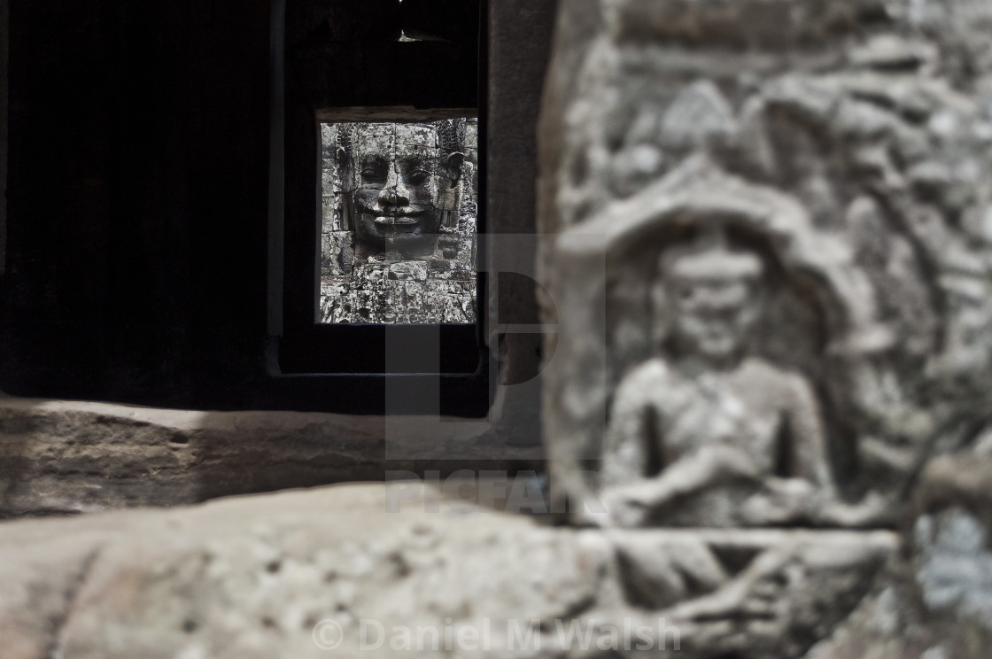 """""""Carving at the top of steps in Bayon Temple Cambodia. (depth of field contrast piece 1 of 2)"""" stock image"""