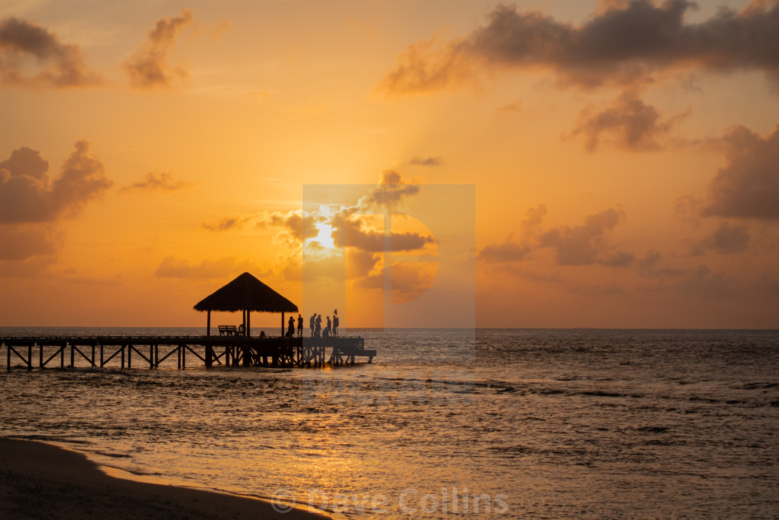 """End of Pier, Sunset Party, Maldives"" stock image"