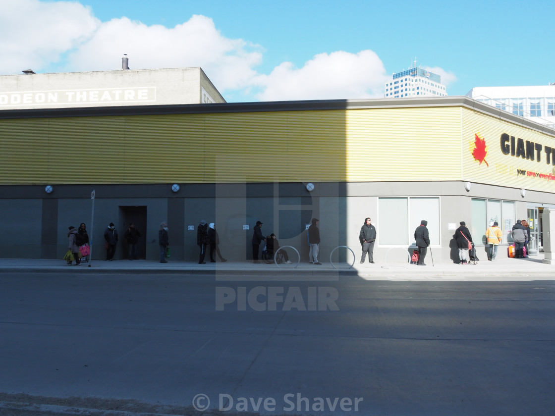 """""""COVID-19 shoppers' queue at Giant Tiger in downtown Winnipeg"""" stock image"""