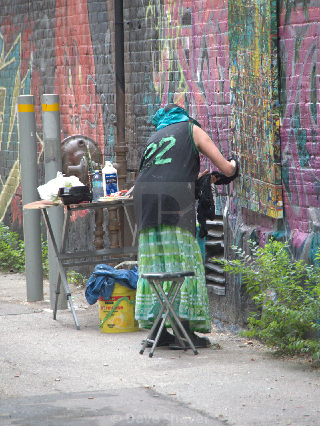 """""""Lady painter painting in an outside alley"""" stock image"""