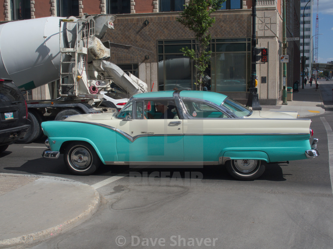 """""""Classic 1950s Crown Victoria driving downtown"""" stock image"""