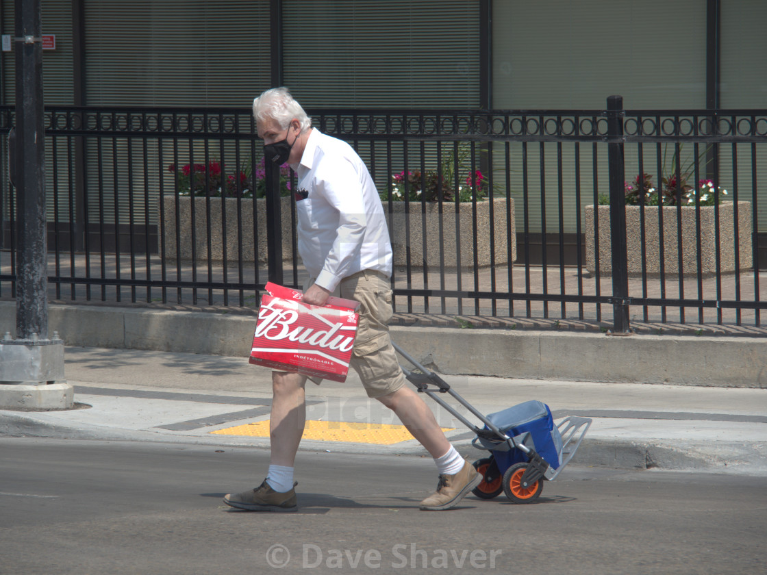 """""""Man With A Beer Carton And A Trolley"""" stock image"""