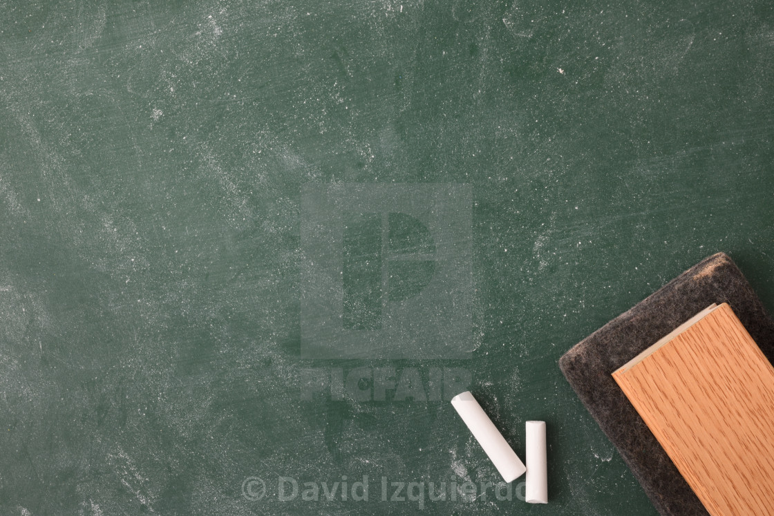 """Dirty blackboard with white chalk and eraser top detail"" stock image"