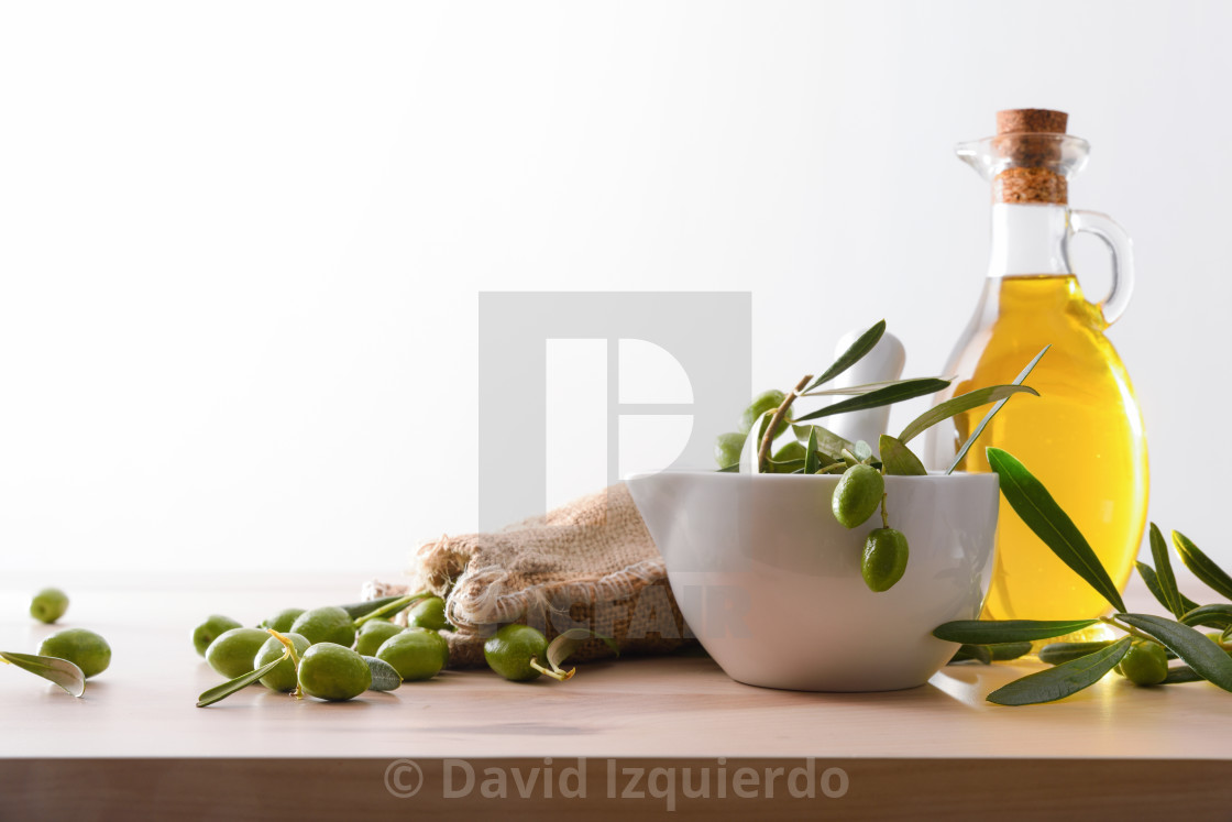 """Natural olive oil homemade from organic farming white background"" stock image"