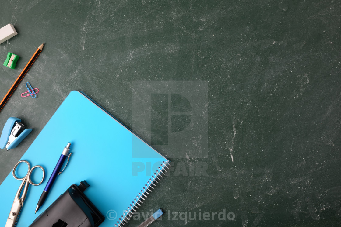"""""""Office supplies on green blackboard top view"""" stock image"""