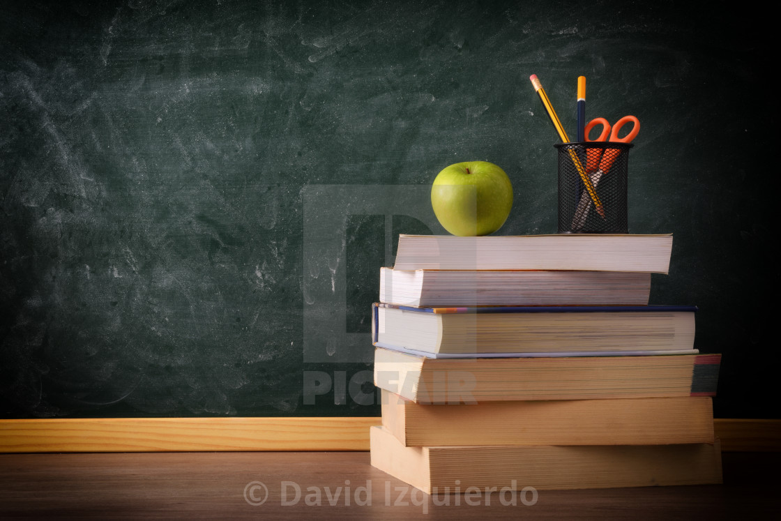 """""""Stack of books on class table"""" stock image"""