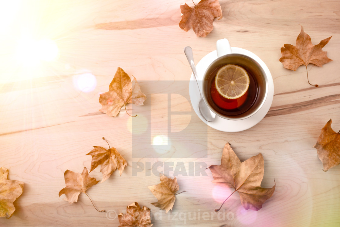 """""""Tea with lemon on wooden table with leaves sunny top"""" stock image"""