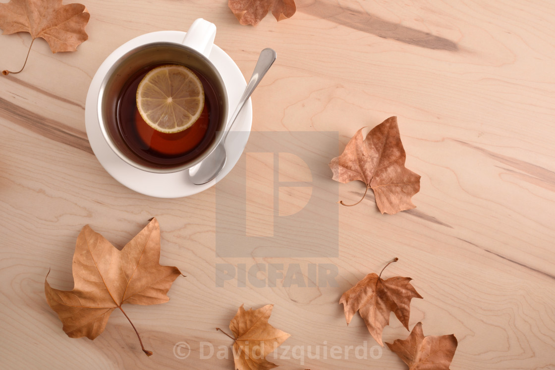 """""""Tea with lemon on wooden table with leaves top view"""" stock image"""