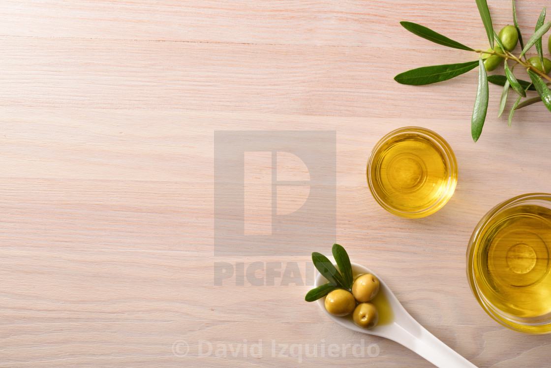 """""""Vegetable olive oil in glass bowls on kitchen bench top"""" stock image"""