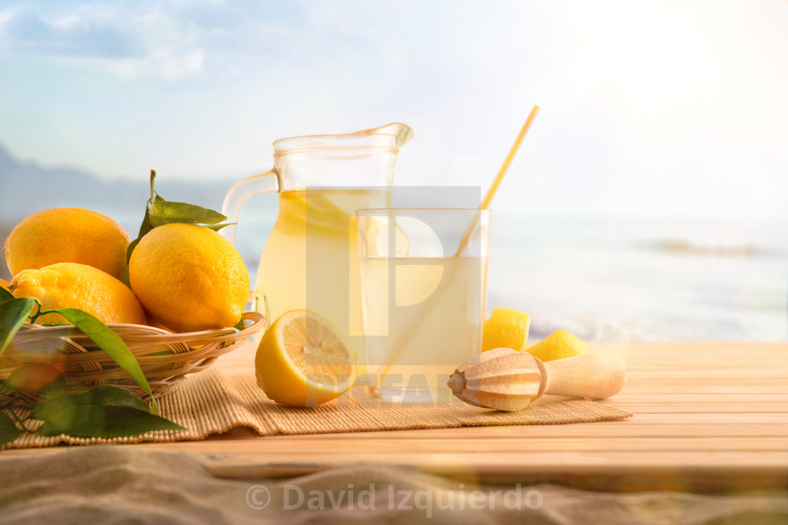 """""""Breakfast with Jug and glass with lemonade on the beach"""" stock image"""