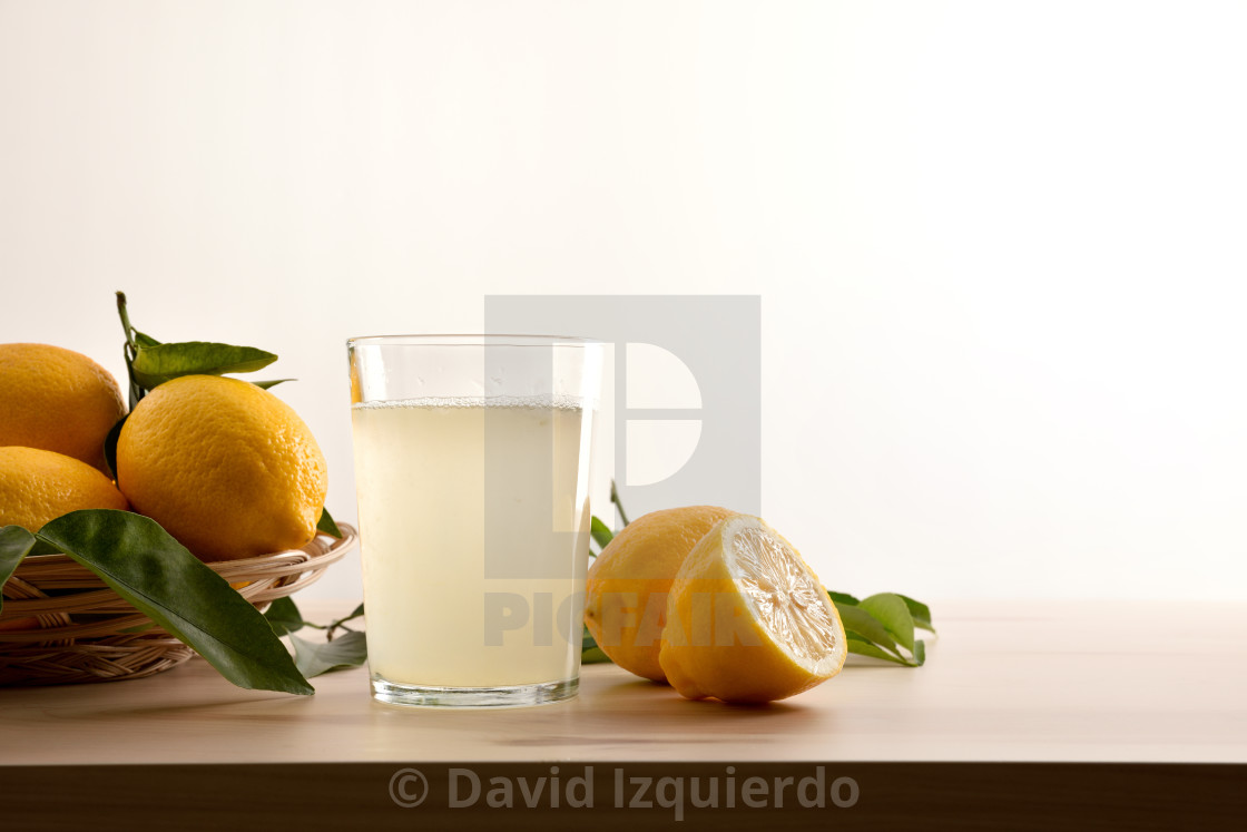 """""""Glass with water with lemon on wooden table white background"""" stock image"""