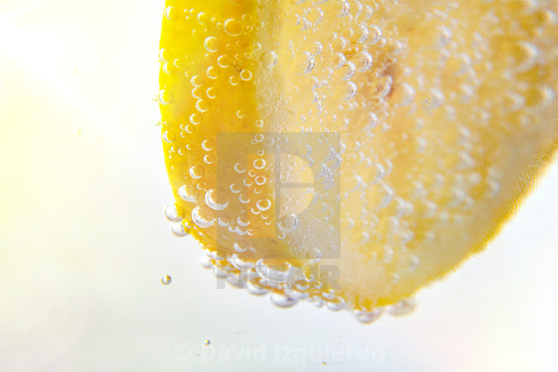 """""""Lemon dipped in water full of bubbles"""" stock image"""