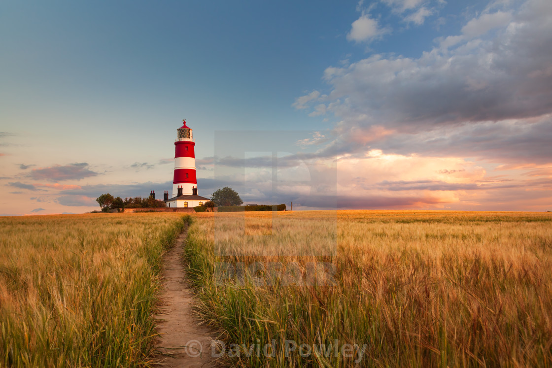 """Clouds Over Happisburgh Lighthouse Norfolk"" stock image"