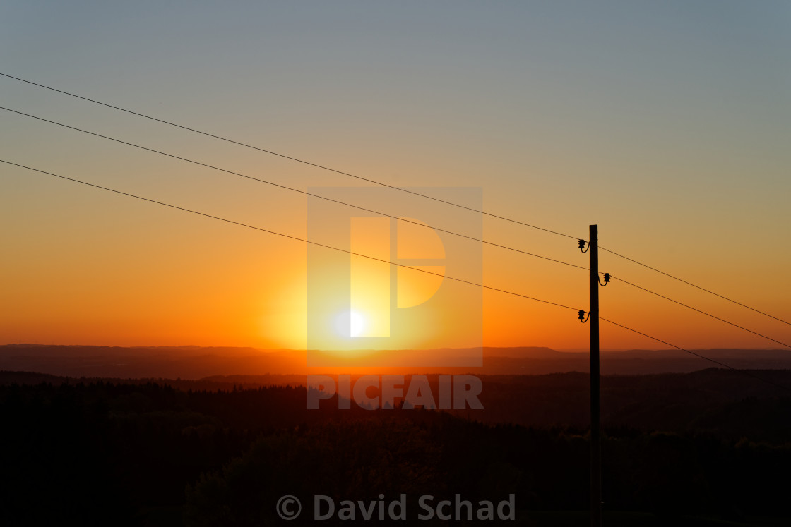 """""""Power line in front of sunset"""" stock image"""