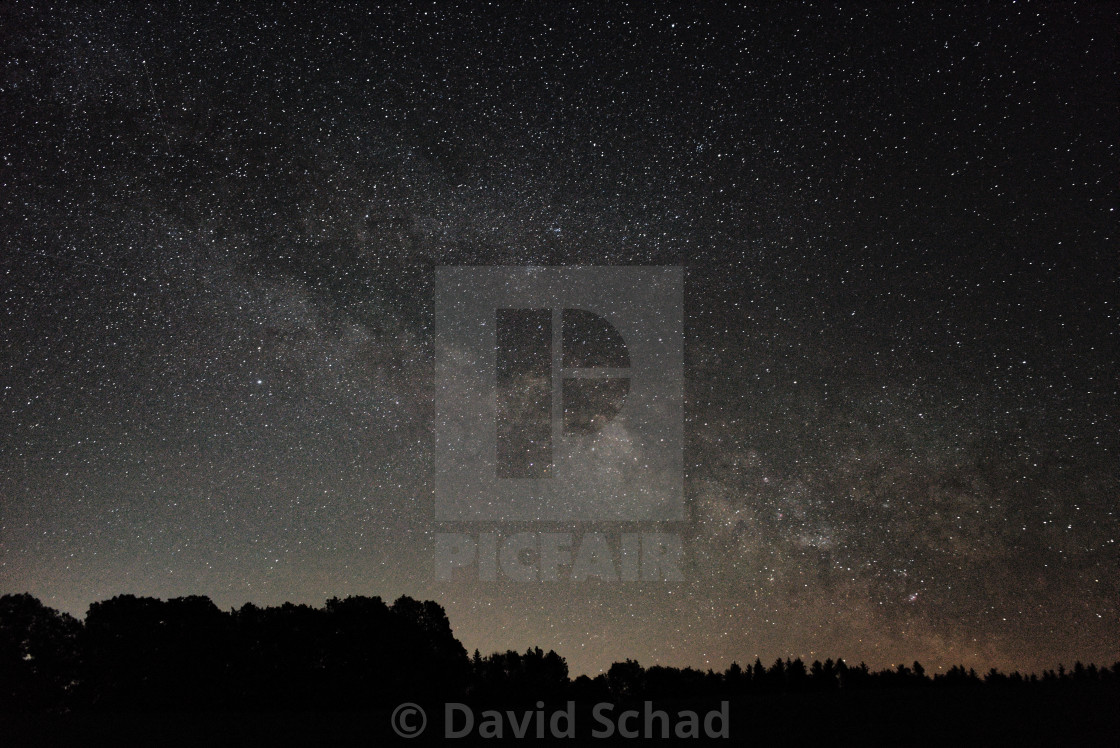 """""""Milky way over forest silhouette"""" stock image"""