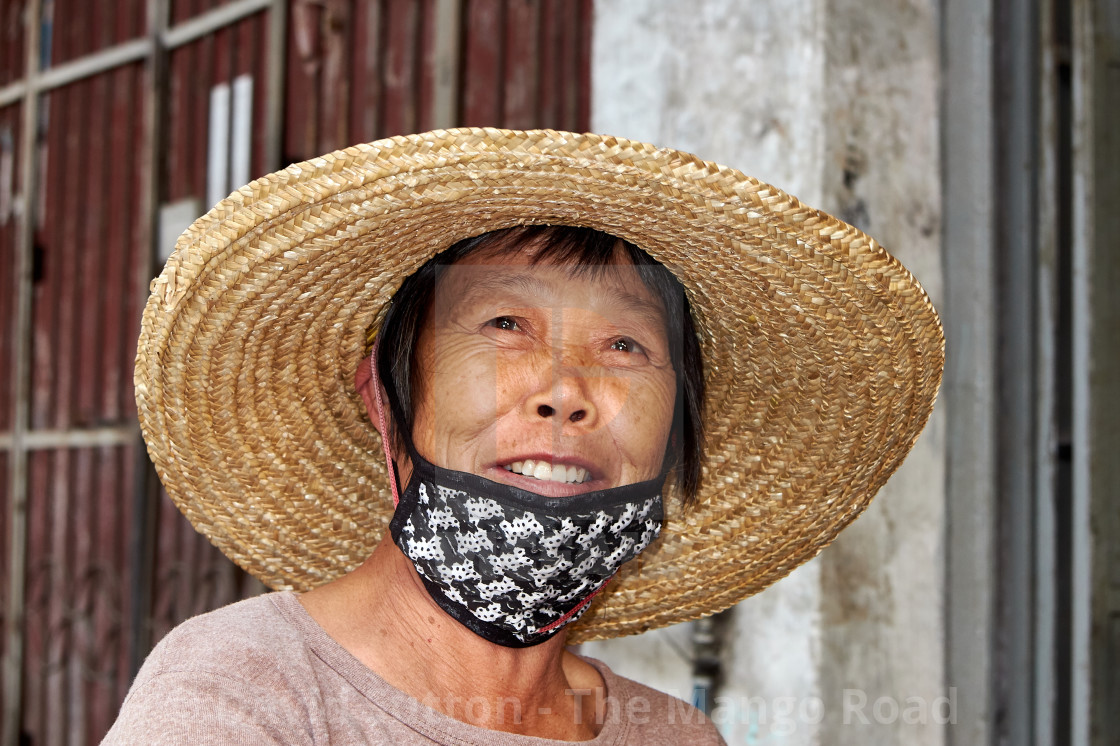"""A smiling Chinese woman wearing a straw hat in Chikan old town, Kaiping, China"" stock image"