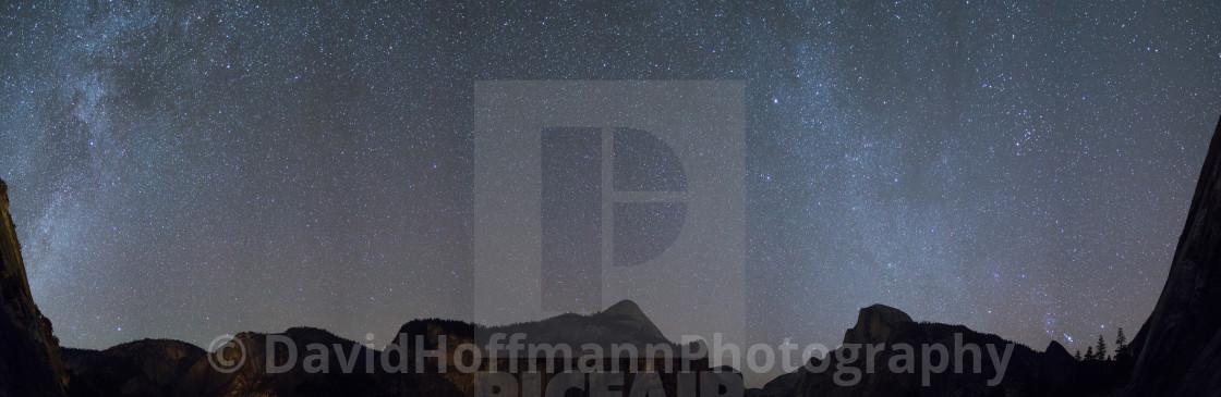 """Milky Way Galaxy over the panoramic Yosemite Valley."" stock image"