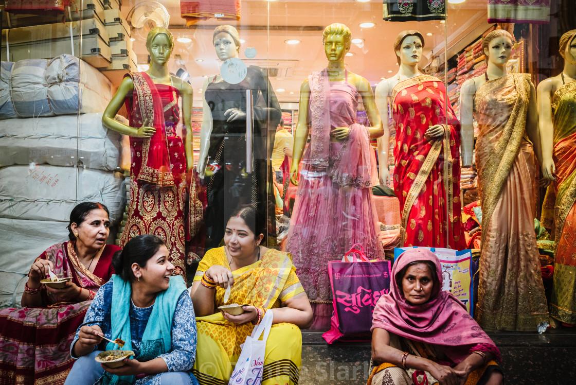 """Indian ladies sat in front of sari shop"" stock image"
