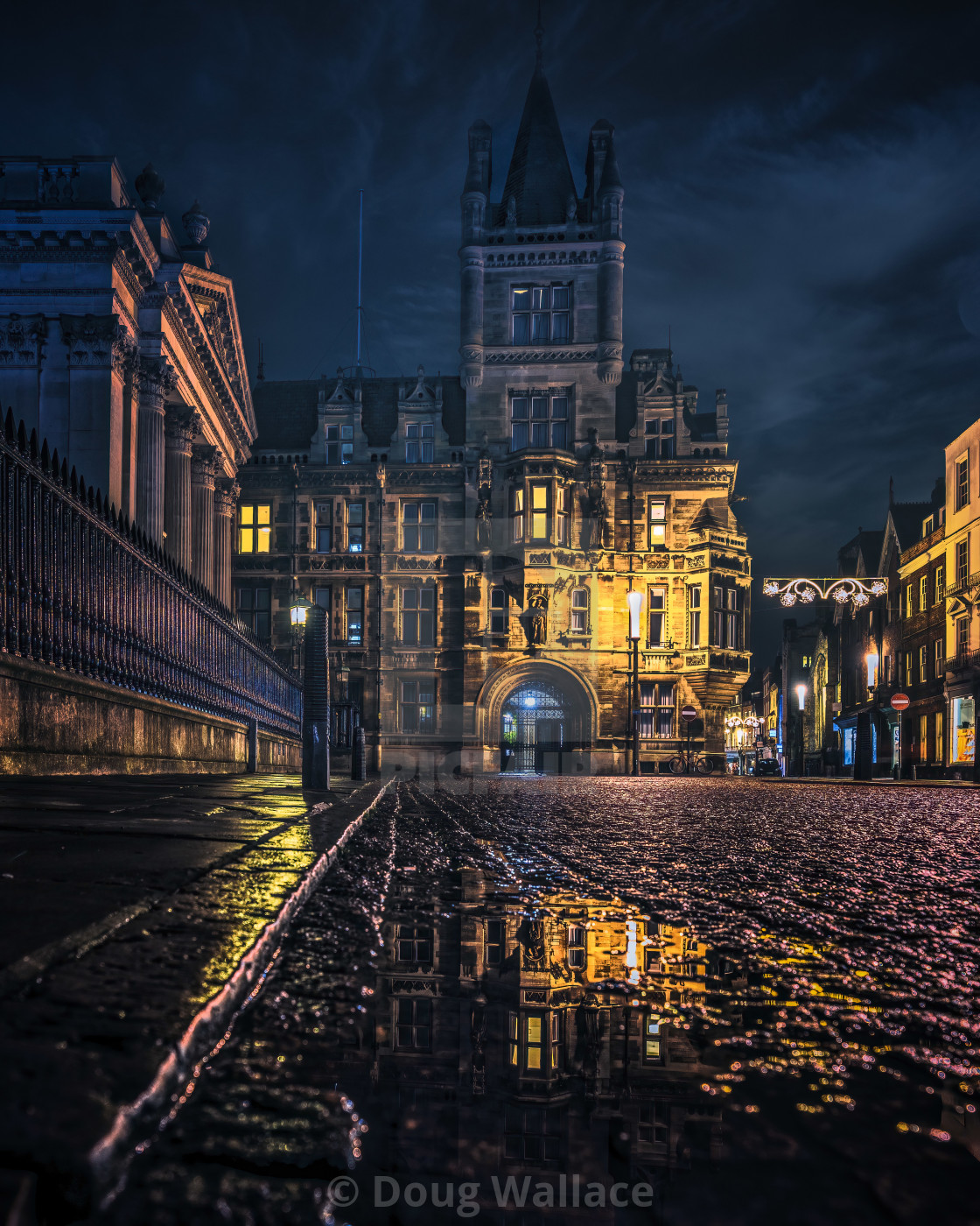 """Night reflections of Gonville & Caius, University of Cambridge UK."" stock image"