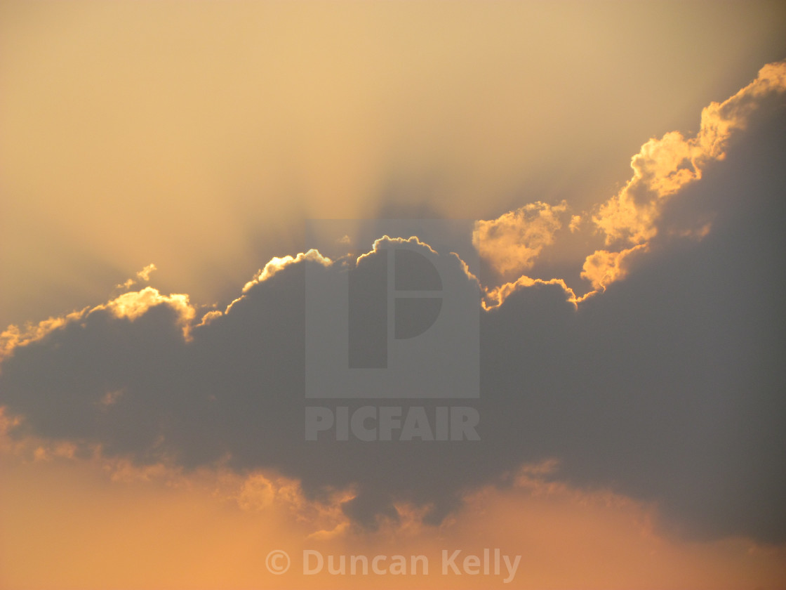 """""""A cloud with a golden lining"""" stock image"""