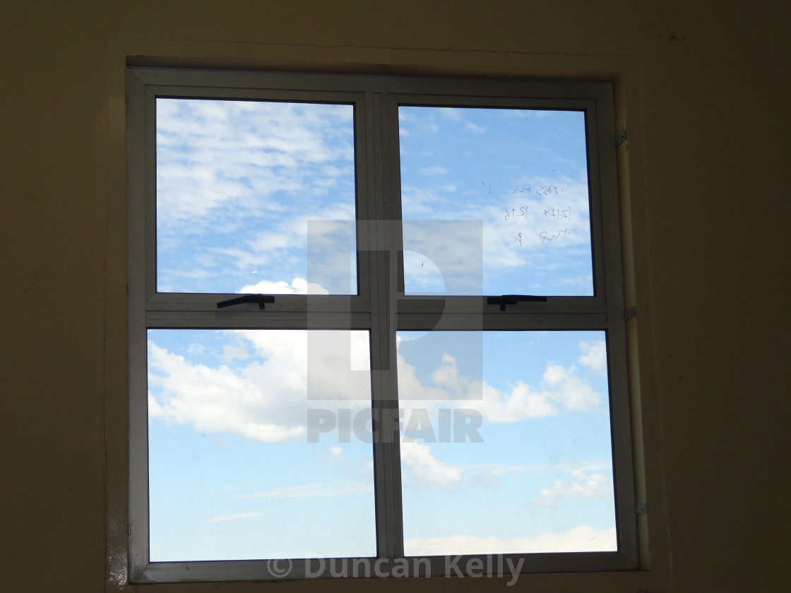 """""""A classic window with a view of the sky through it."""" stock image"""