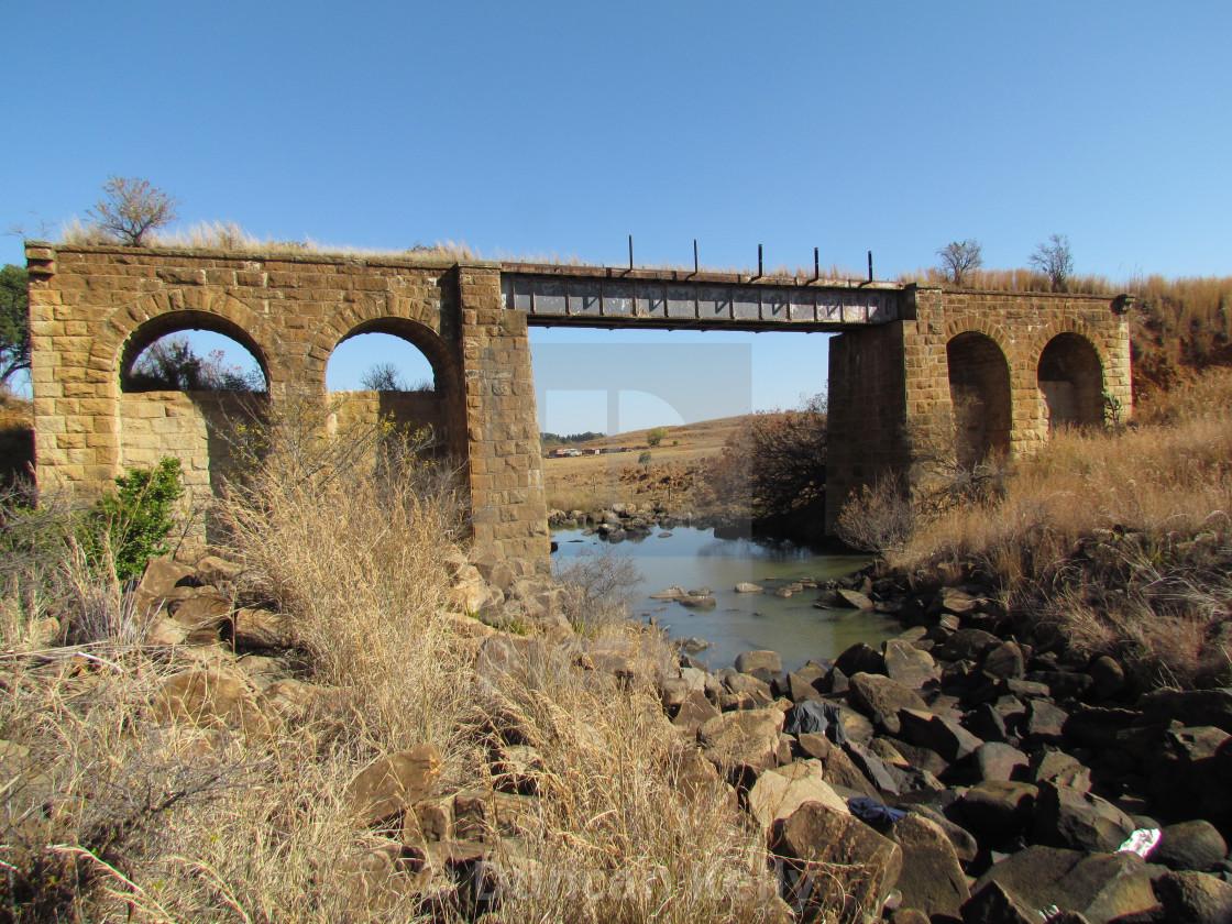 """An old damaged sandstone railway bridge"" stock image"