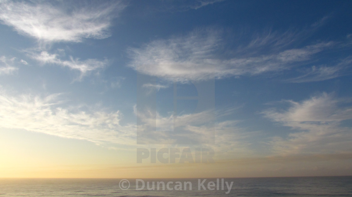 """""""High cirrus clouds over the Dolphin coast"""" stock image"""