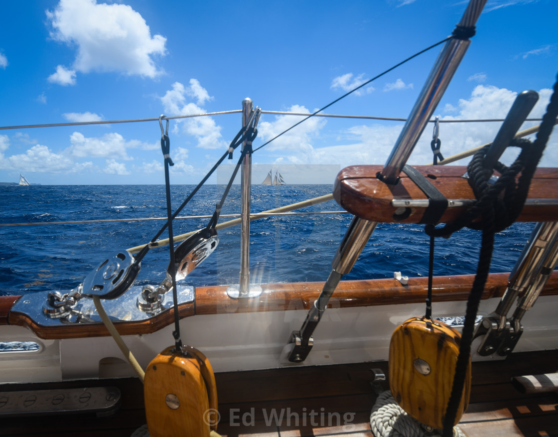 """""""From the deck of Aschanti IV looking over at the sails of Columbia."""" stock image"""