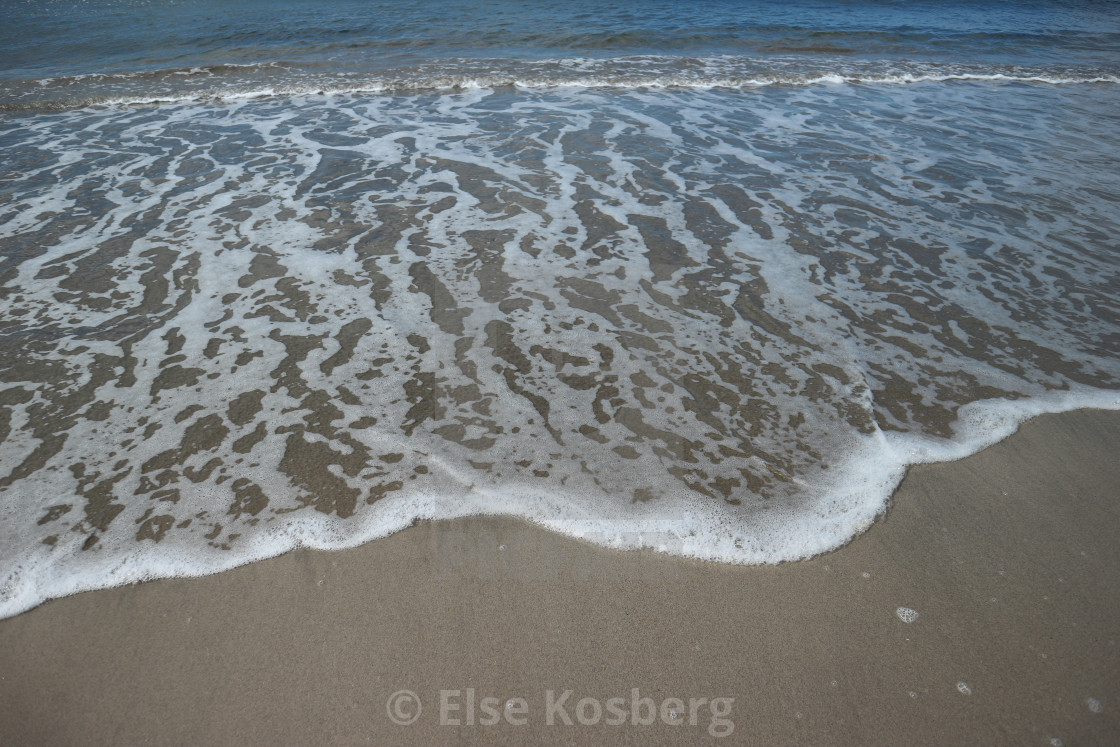 """Sea rushing to the shore"" stock image"
