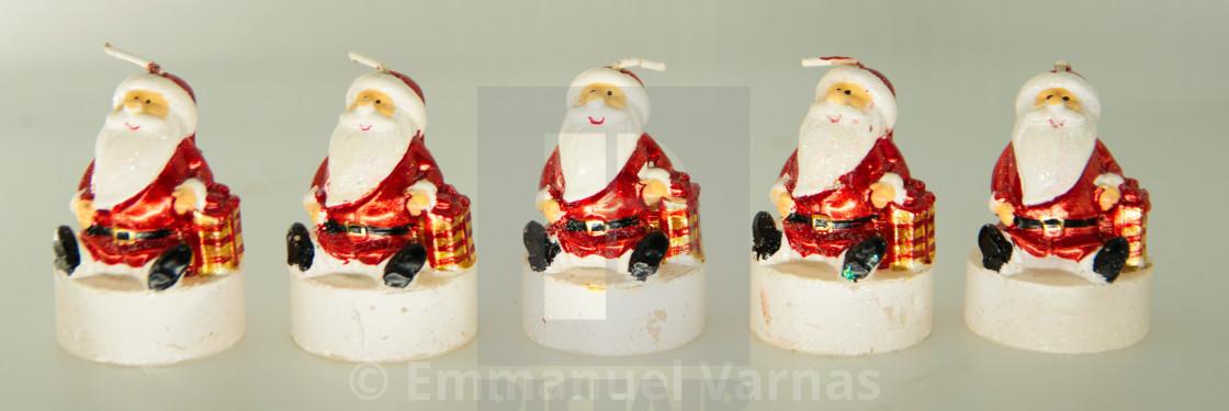 """A line of christmas santa claus figurines"" stock image"