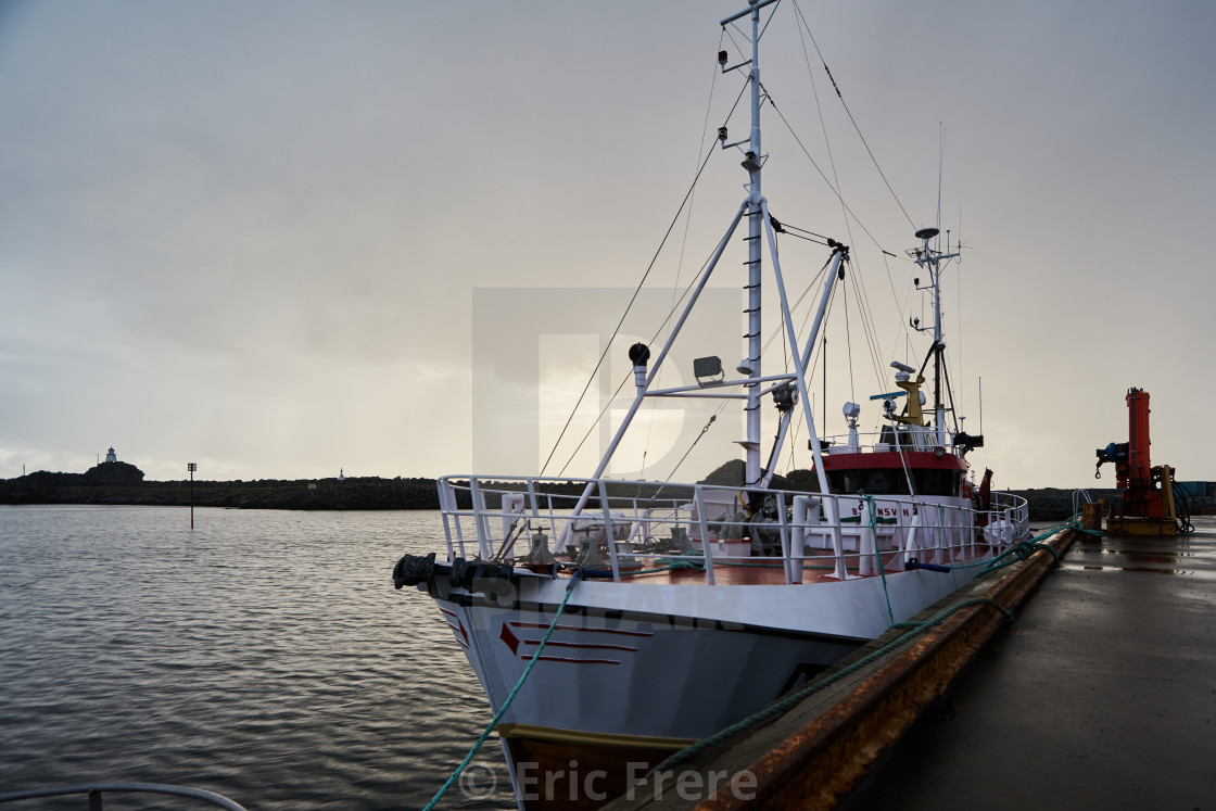 """Docked at Stamsund Pier"" stock image"