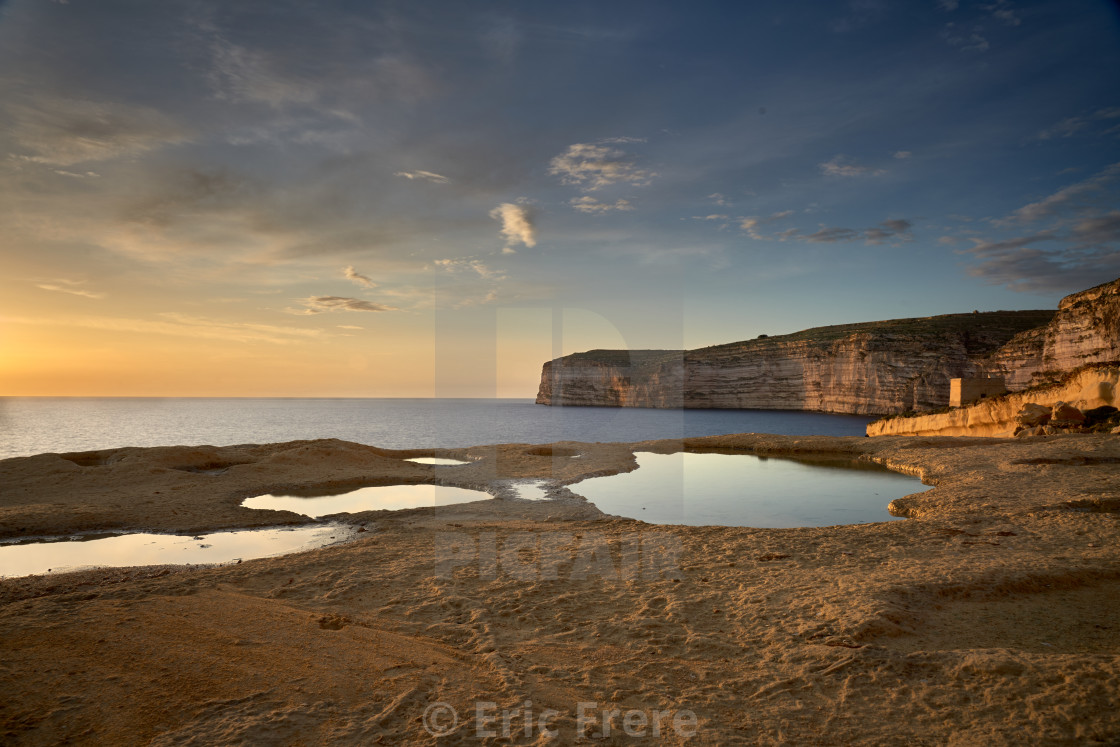 """Sunset at Xlendi Bay"" stock image"
