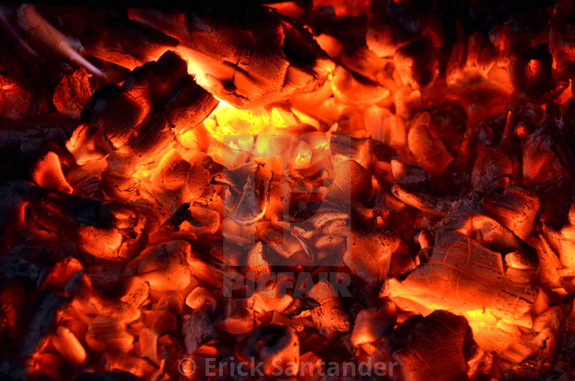 """Hot sparking live-coals burning in a barbecue"" stock image"