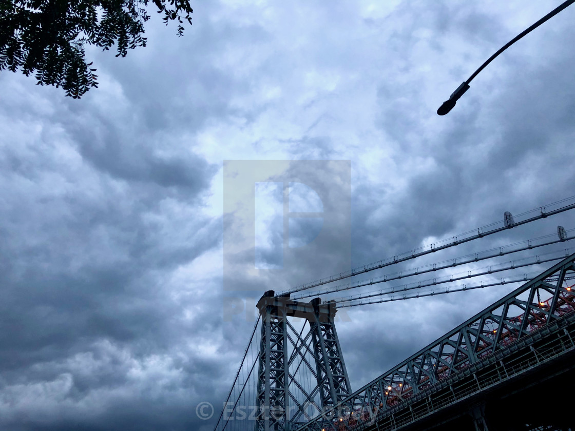"""Cloudy sky above Williamsburg Bridge, 2019"" stock image"