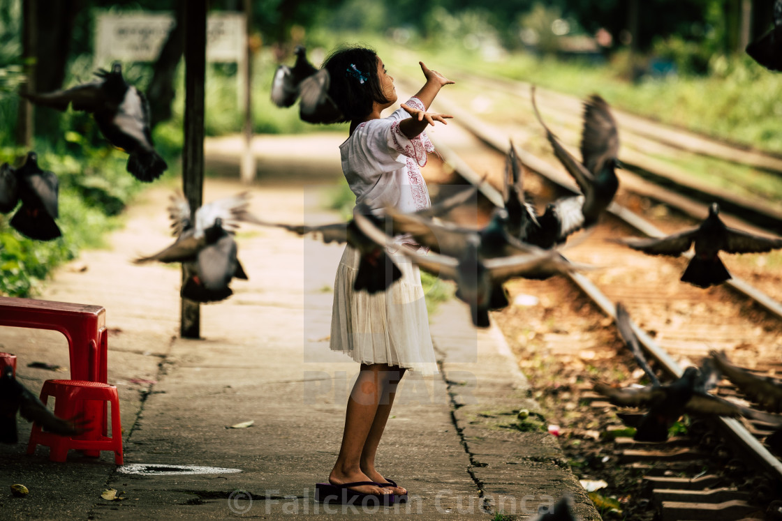 """""""Girl and doves"""" stock image"""