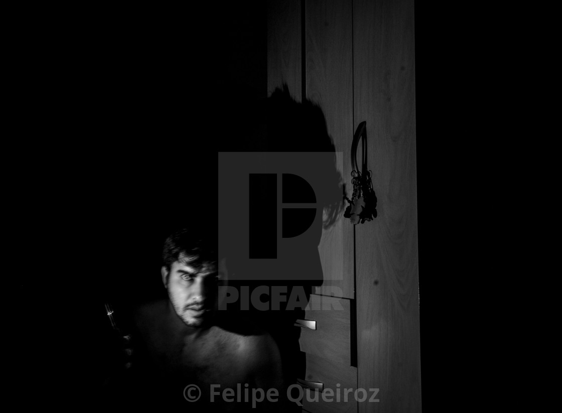 """""""man with cell phone light in the dark 3"""" stock image"""