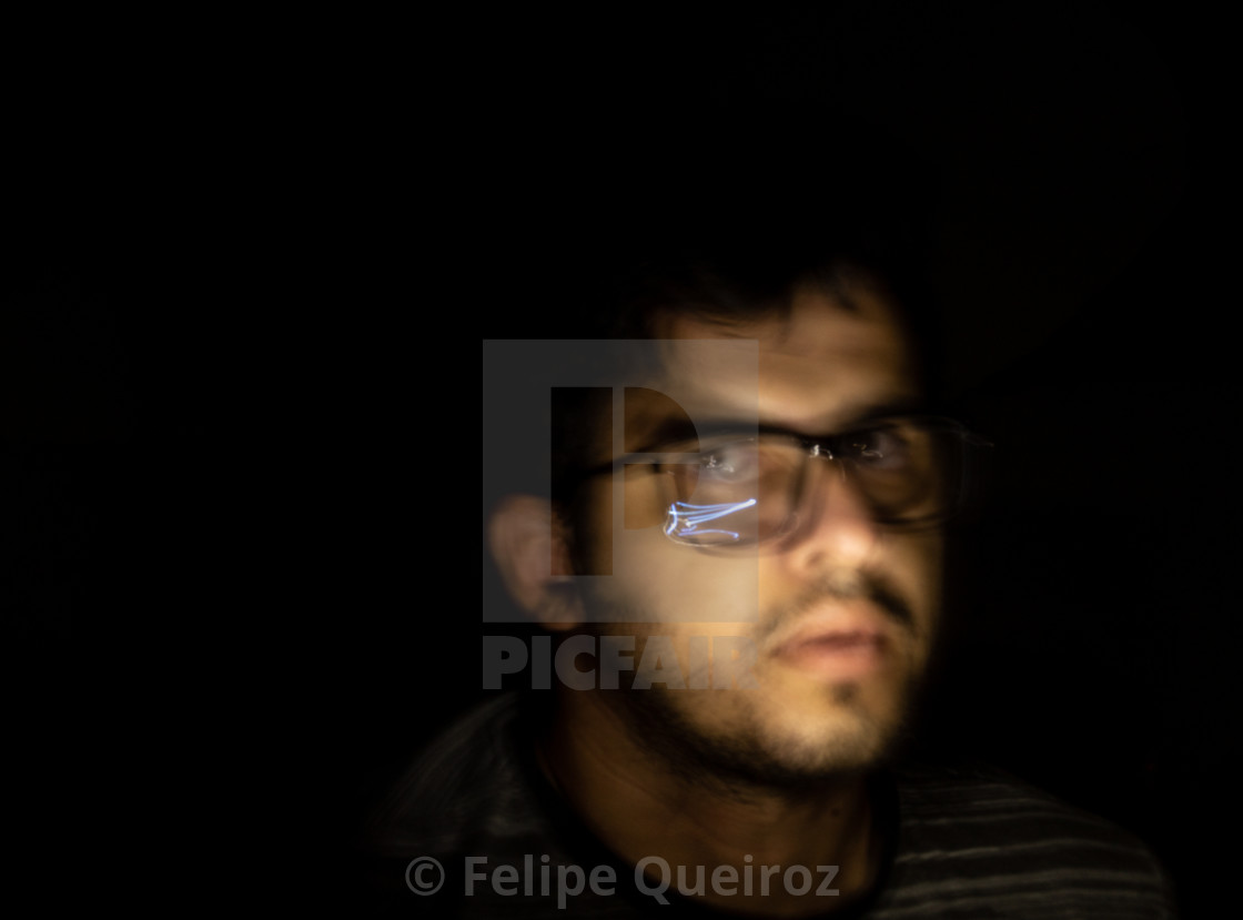 """""""man with cell phone light in the dark 69"""" stock image"""