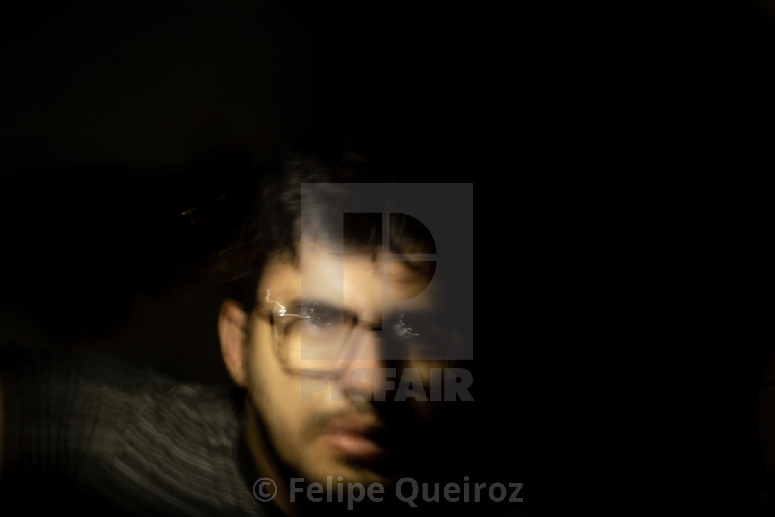 """""""man with cell phone light in the dark 421"""" stock image"""