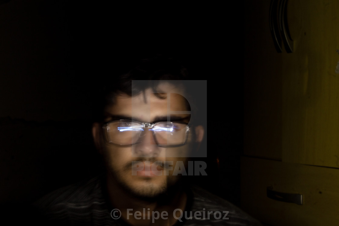 """""""man with cell phone light in the dark 336"""" stock image"""