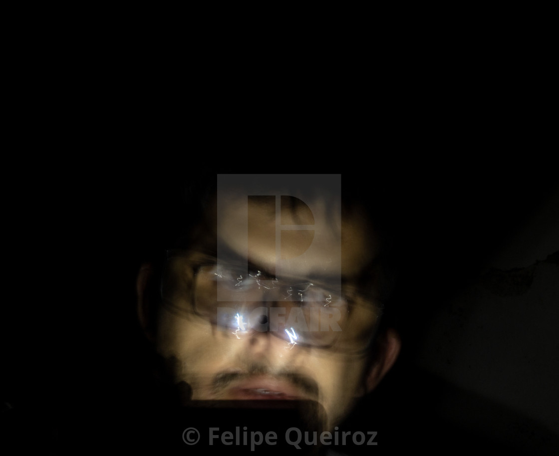 """""""man with cell phone light in the dark 96"""" stock image"""