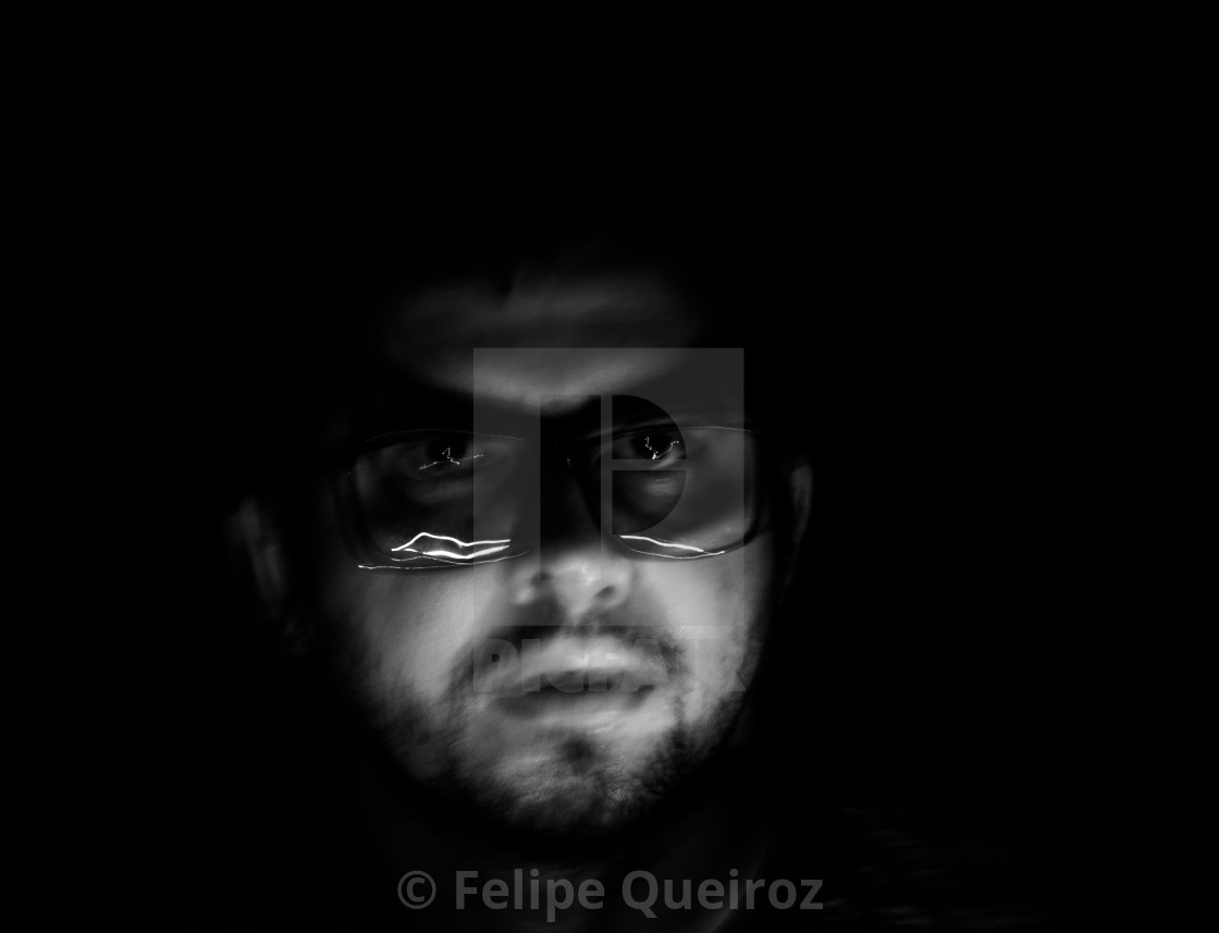 """""""man with cell phone light in the dark (end photo)"""" stock image"""