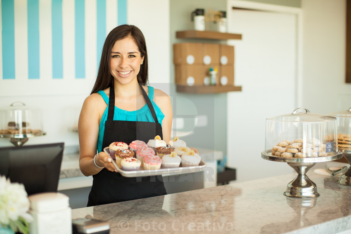 """Gorgeous woman selling cupcakes"" stock image"