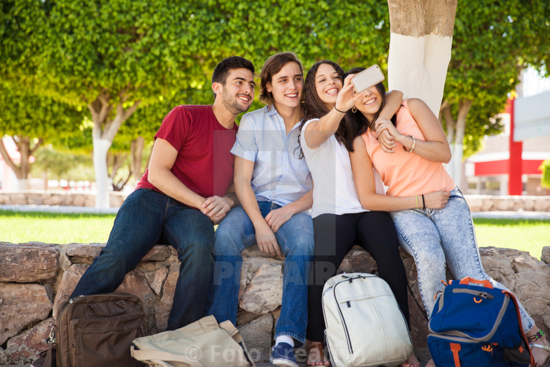 """College friends taking selfie"" stock image"
