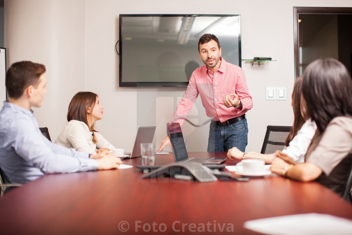 """Group of people in a meeting"" stock image"
