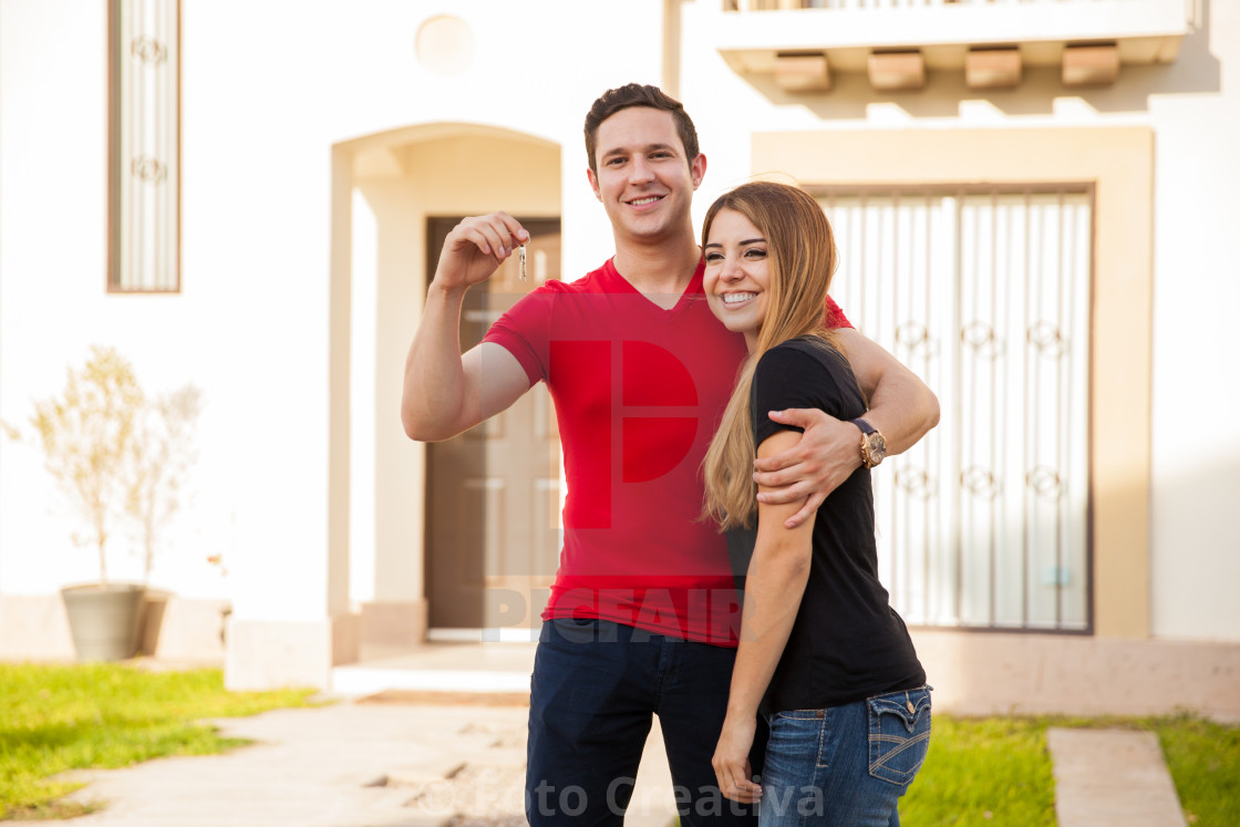 """Happy couple with a new house"" stock image"