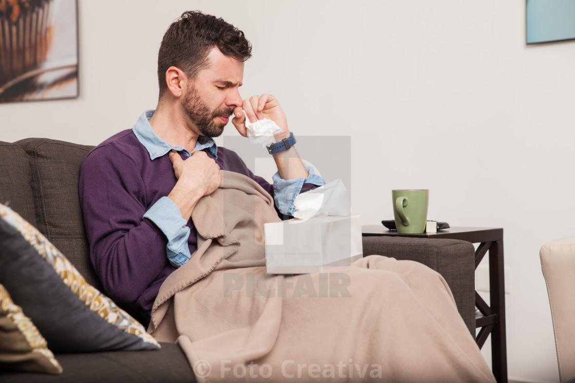 """Man fighting a cold at home"" stock image"