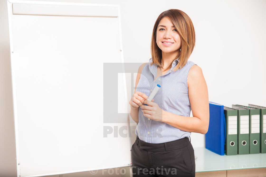 """Young female tutor about to give a presentation"" stock image"