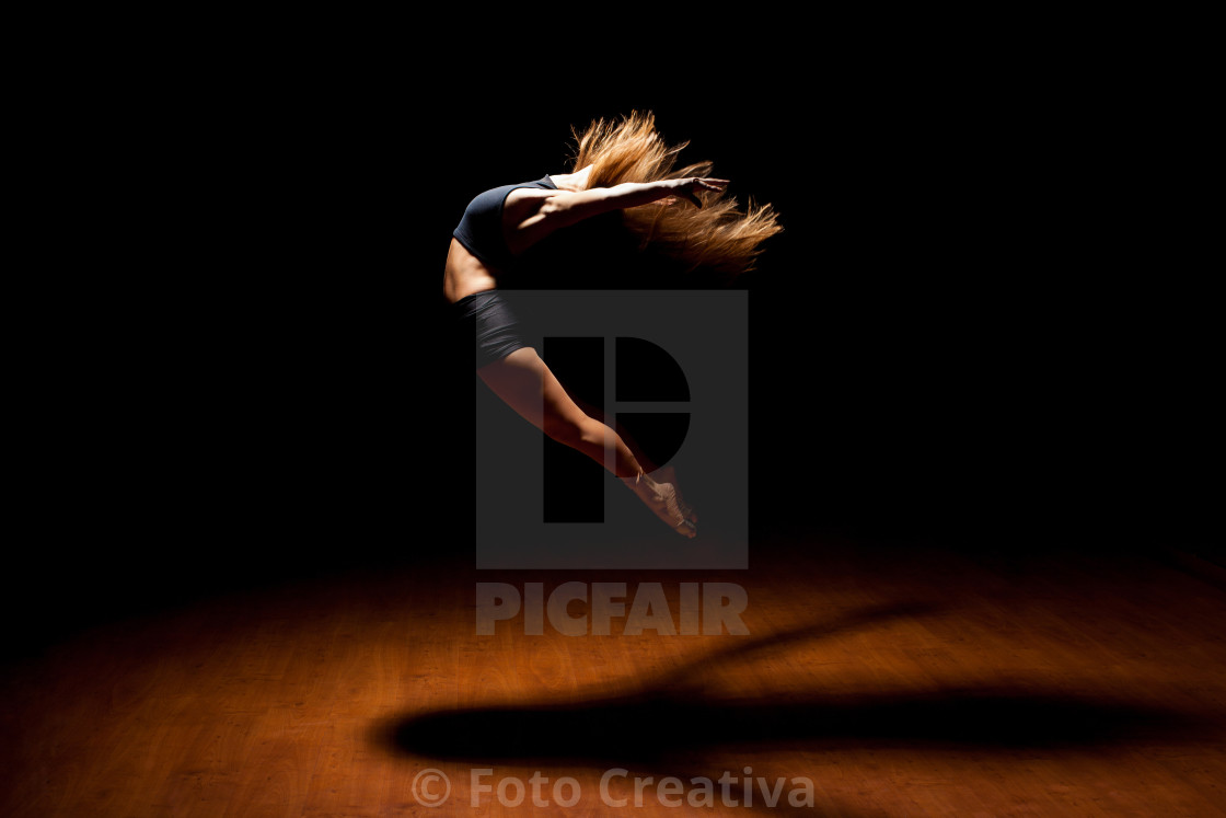 """Beautiful dancer jumping in a stage"" stock image"