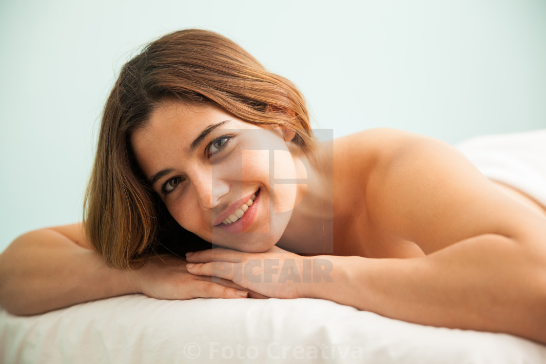 """Gorgeous brunette in a spa bed"" stock image"